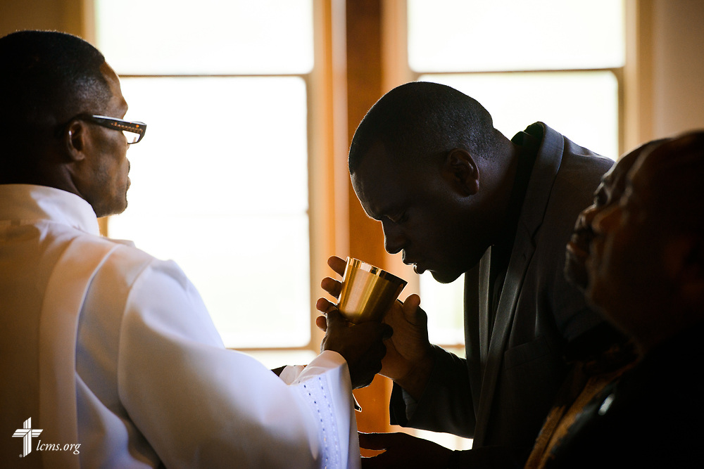 Vicar Daniel Keah distributes the Sacrament to Joseph Lewis, a seminarian in the Ethnic Immigrant Institute of Theology (EIIT) program at Concordia Seminary, St. Louis, at worship on Sunday, Aug. 6, 2017, at Lamb of God Lutheran Church, housed in Ascension Lutheran Church, Landover Hills, Md. LCMS Communications/Erik M. Lunsford