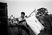 colombia1063 - civilians are caught in the crossfire between government troops and FARC guerrillas, near Puerto Rico, soon after 3 years of peace talks came to a sudden end. Caqueta march 2002<br />