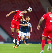 4th September 2017, Hampden Park, Glasgow, Scotland; World Cup Qualification, Group F; Scotland versus Malta; Malta's Bjorn Kristensen out jumps Scotland's James McArthur