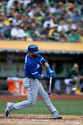 OAKLAND, CA - JULY 23:  Jose Bautista #19 of the Toronto Blue Jays at bat against the Oakland Athletics during the third inning at O.co Coliseum on July 23, 2015 in Oakland, California. The Toronto Blue Jays defeated the Oakland Athletics 5-2. (Photo by Jason O. Watson/Getty Images) *** Local Caption *** Jose Bautista