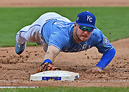 Kansas City Royals first baseman Ryan O'Hearn (66) makes a diving tag at first base, to force out Minnesota Twins center fielder Max Kepler (not pictured) during the fourth inning at Kauffman Stadium.
