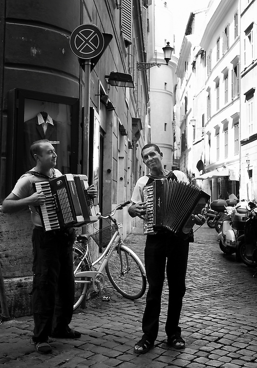 Street musicians playing accordions on the streets of Rome, Italy