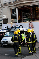 © Licensed to London News Pictures. 07/03/2012. London, UK. Police, Ambulance and Fire crews on Oxford Street where a temporary shop front for Mango collapsed, injuring three people- A man (Approx 60), and two women (approx 30 and 40) A police officer on the scene said the shop front collapsed because builders renovating shop placed heavy steel poles on the wooden facade, causing it to collapse. the  . : James Gourley/LNP