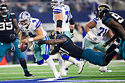 ARLINGTON, TX - OCTOBER 14:  Dak Prescott #4 of the Dallas Cowboys runs the ball and is tackled from behind by Yannick Ngakoue #91 of the Jacksonville Jaguars at AT&T Stadium on October 14, 2018 in Arlington, Texas.  The Cowboys defeated the Jaguars 40-7.  (Photo by Wesley Hitt/Getty Images) *** Local Caption *** Dak Prescott; Yannick Ngakoue