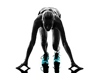 one caucasian woman runner running jogger jogging on starting blocks  in studio silhouette isolated on white background