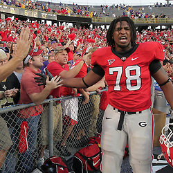 25 October 2008:  Georgia tackle Josh Davis (78) celebrates with fans in the Georgia section after the Georgia Bulldogs 52-38 victory over the LSU Tigers at Tiger Stadium in Baton Rouge, LA.