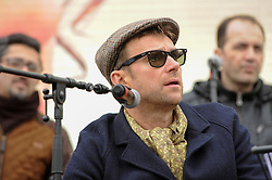 """© Licensed to London News Pictures. 26/02/2017. London, UK. Damon Albarn, Blur singer, on stage with The Orchestra of Syrian Musicians ahead of the special premiere free screening of the Oscar-nominated, Best Foreign Language Film, """"The Salesman"""", in Trafalgar Square, hosted by Mayor of London, Sadiq Khan.  The film's Iranian director, Asghar Farhadi, decided to boycott tonight's main Oscars ceremony in Hollywood, in solidarity with those affected by President Donald Trump's travel ban on people from seven Muslim majority countries (including Iran) from entering the USA.   Photo credit : Stephen Chung/LNP"""