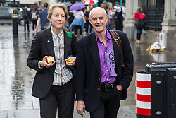 London, UK. 18 June, 2019. Dr Gail Bradbrook and Donnachadh McCarthy of Extinction Rebellion pass Parliament after giving evidence to MPs from the Business, Energy and Industrial Strategy Committee at Portcullis House together with representatives of the World Wildlife Fund (WWF) and the Environmental Defence Fund on clean growth strategy and International Climate Change targets.