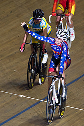 © Licensed to London News Pictures. 20/02/2011. Sarah Hammer of the USA and team Ouch takes first place in the Women's Omnium Scratch Race at the UCI Track Cycling World Cup in Manchester today (20/02/2011). Photo credit should read: Reuben Tabner/LNP