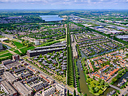 Nederland, Utrecht, Utrecht; 14–05-2020; stadsdeel Leidsche Rijn, gezien vanuit de wijk Terwijde met het Waterwinpark. Zicht op de bomenrij van de Rijnkennemerlaan, richting Haarrijnse Plas.<br /> Leidsche Rijn district, Terwijde district in the foreground. View on the trees of the De Rijnkennemerlaan.<br /> <br /> luchtfoto (toeslag op standaard tarieven);<br /> aerial photo (additional fee required)<br /> copyright © 2020 foto/photo Siebe Swart
