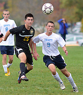 TOWAMENCIN, PA - OCTOBER 7: Central Bucks West's Nick DiPietro #25 makes a pass as North Penn's Eric Rosenblatt #9 defends in the first half at North Penn high school October 7, 2014 in Towamencin, Pennsylvania. (Photo by William Thomas Cain/Cain Images)