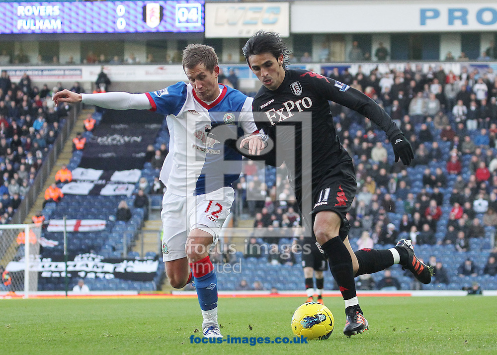 Picture by MIchael Sedgwick/Focus Images Ltd. 07900 363072.14/01/12.Morten Gamst Pedersen of Blackburn and Bryan Ruiz of Fulham in action during the Barclays Premier League match at the Ewood Park stadium, Blackburn, Lancashire.