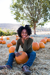 Smiling African American Woman in a Pumpkin Patch