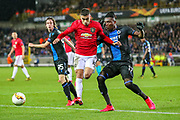 Manchester United midfielder Andreas Pereira (15) tussles with Club Brugge defender Simon Deli (17) during the Europa League match between Club Brugge and Manchester United at Jan Breydel Stadion, Brugge, Belguim on 20 February 2020.