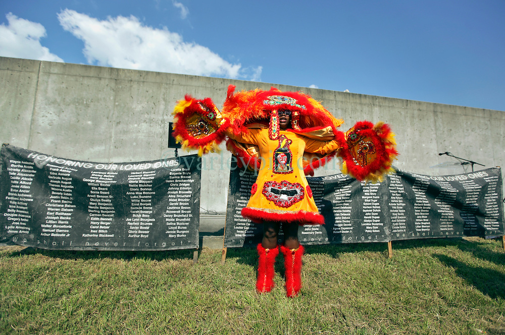29 August 2015. Lower 9th Ward, New Orleans, Louisiana.<br /> Hurricane Katrina 10th anniversary memorial.<br /> Mary Kay, second Queen of the Wild Tchoupitoulas Mardi Gras Indians at the levee wall which gave way a decade earlier. <br /> Photo credit&copy;; Charlie Varley/varleypix.com.