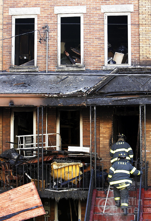 New York City firefighters enter a house where 9 people were killed, 8 of them children, in an overnight fire in the Bronx, New York on Thursday 08 March 2007.