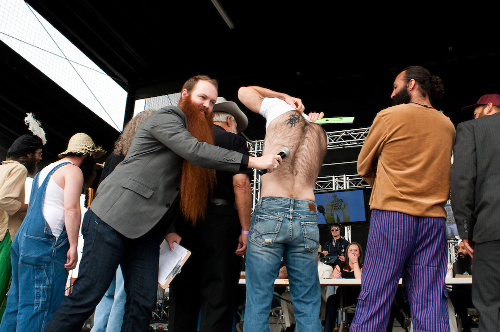 Host Jack Passion examines the back hair of competitor Devin Cara in Bend, Oregon on Saturday, June 5, 2010 at the Beard Team USA National Beard and Mustache Championships. Cara took third in the full beard division.