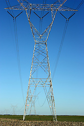 Electrical lines stream across the landscape from tower to tower carrying the power necessary for us to carry on our daily activities.