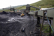 A section of Tower Colliery, the last deep mine in Wales, is pictured on Tuesday, June 19, 2007, in Hirwaun, Vale of Neath, South Wales. The time is ripe again for an unexpected revival of the coal industry in the Vale of Neath due to the increasing prize and diminishing reserves of oil and gas, the uncertainties of renewable energy sources, and the technological advancement in producing energy from coal while limiting emissions of pollutants, has created the basis for valuable investment opportunities and a possible alternative to the latest energy crisis. Unity Mine, in particular, has started a pioneering effort to revive the coal industry in the area, reopening after more than 8 years with the intent of exploiting the large resources still buried underground. Coal could be then answer to both, access to cheaper and paradoxically greener energy and a better and safer choice than nuclear energy as a major supply for the decades to come. It is estimated that coal reserves in Wales amount to over 250 million tonnes, or the equivalent of at least 50 years of energy supply, while the worldwide total coal could last for over 200 years as a viable resource compared to only a few decades of oil and natural gas.