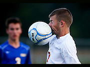Knightstown high school soccer player Chris Saunders gets a face full of ball during the first half of play at Centerville.