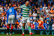 Celtic Captain Scott Brown gives Jermain Defoe of Rangers FC a pat on the back during the Ladbrokes Scottish Premiership match between Rangers and Celtic at Ibrox, Glasgow, Scotland on 12 May 2019.