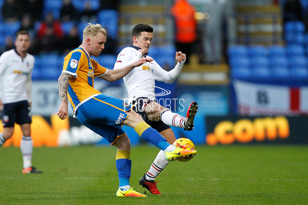 Shrewsbury's Jack Grimmer (14) and Bolton's Zach Clough (10) during the EFL Sky Bet League 1 match between Bolton Wanderers and Shrewsbury Town at the Macron Stadium, Bolton, England on 26 December 2016. Photo by Craig Galloway.