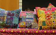 Vintage Sari patchwork cushion covers at Miracle Boutique in Lindale Mall in Cedar Rapids on Saturday, December 14, 2013.