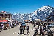 BMW saloon car arrives at Cima Coppi on The Stelvio Pass, Passo dello Stelvio, Stilfser Joch, to join motoring fans, Italy