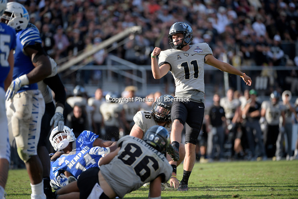 Central Florida place kicker Matthew Wright (11) watches a field goal attempt during the second half of the American Athletic Conference championship NCAA college football game against Memphis Saturday, Dec. 2, 2017, in Orlando, Fla. Central Florida won 62-55. (Photo by Phelan M. Ebenhack)