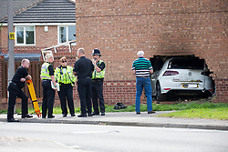 © Licensed to London News Pictures. 03/09/2017. York UK. Police at the scene in York where a car has crashed through the wall of a house on Rivelin Way. The car burst into flames setting the house alight. Four people have been injured three of them are serious including a man who was in the living room at the time of the incident & has suffered severe lower limb injuries. A woman & child who where in the house have escaped without injury. Photo credit: Andrew McCaren/LNP