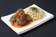 a serving of meatballs tomato sauce and rice