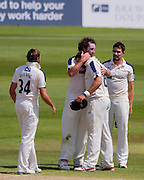 Tim T Bresnan, Team Captain (Yorkshire CCC) is congratulated by his team mates Ryan J Sidebottom and others after winning the match against Durham County Cricket Club in the LV County Championship Div 1 match between Durham County Cricket Club and Yorkshire County Cricket Club at the Emirates Durham ICG Ground, Chester-le-Street, United Kingdom on 1 July 2015. Photo by George Ledger.