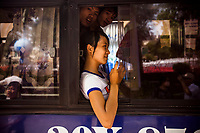 Vietnamese teenagers are bussed into the capital to see the activities during Hanoi's 1,000-year anniversary on October 3, 2010.