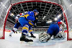 Robert Kristan of Slovenia covers a puck during ice-hockey match between Slovenia and Ukraine at IIHF World Championship DIV. I Group A Slovenia 2012, on April 19, 2012 at SRC Stozice, Ljubljana, Slovenia. (Photo By Matic Klansek Velej / Sportida.com)