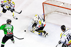 3.01.2014, Hala Tivoli, Ljubljana, SLO, EBEL, HDD Telemach Olimpija Ljubljana vs Dornbirner Eishockey Club, 63rd Game Day, in picture Ken Ograjensek (HDD Telemach Olimpija, #18) vs Adam Dennis (Dornbirner Eishockey Club, #44) during the Erste Bank Icehockey League 63rd Game Day match between HDD Telemach Olimpija Ljubljana and Dornbirner Eishockey Club at the Hala Tivoli, Ljubljana, Slovenia on 2014/01/03. (Photo By Matic Klansek Velej / Sportida)