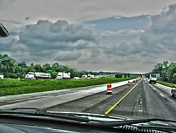 A look through the windshield at a thunderstorm while driving in the rain on an interstate in southern Illionis<br /> <br /> This image was produced in part utilizing High Dynamic Range (HDR) processes.  It should not be used editorially without being listed as an illustration or with a disclaimer.  It may or may not be an accurate representation of the scene as originally photographed and the finished image is the creation of the photographer.
