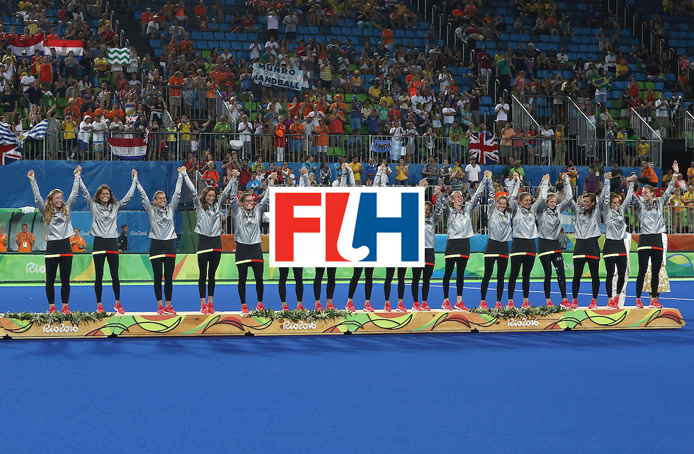 RIO DE JANEIRO, BRAZIL - AUGUST 19:  Germany pose on the podium during the medal ceremony after winning Bronze in the Women's Hockey on Day 14 of the Rio 2016 Olympic Games at the Olympic Hockey Centre on August 19, 2016 in Rio de Janeiro, Brazil.  (Photo by David Rogers/Getty Images)