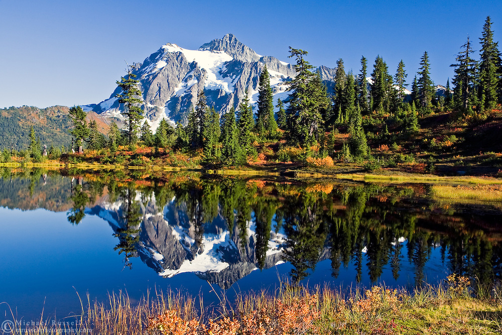 Fall color and Mount Shuksan reflected in Picture Lake in the Heather Meadows area of The Mt. Baker-Snoqualmie National Forest, Washington State, USA