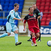 St Johnstone v Bristol City....28.07.12  Pre-Season Friendly<br /> Ex-saint Jody Morris closed down by Kevin Moon<br /> Picture by Graeme Hart.<br /> Copyright Perthshire Picture Agency<br /> Tel: 01738 623350  Mobile: 07990 594431