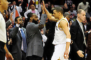 April 13, 2011; Cleveland, OH, USA; Cleveland Cavaliers shooting guard Anthony Parker (18) celebrates with point guard Baron Davis (85) and power forward Antawn Jamison (4) during the fourth quarter against the Washington Wizards at Quicken Loans Arena. The Cavaliers beat the Wizards 100-93. Mandatory Credit: Jason Miller-US PRESSWIRE