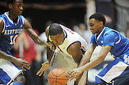 """Mississippi's Martavious Newby (1) is fouled by Kentucky's Ryan Harrow (12) as Kentucky's Archie Goodwin (10) also defends at the C.M. """"Tad"""" Smith Coliseum on Tuesday, January 29, 2013.  (AP Photo/Oxford Eagle, Bruce Newman).."""