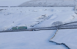 © Licensed to London News Pictures. <br /> 12/12/2014. <br /> <br /> Cumbria, United Kingdom<br /> <br /> A lorry drives across the A66 in Cumbria as snow lies in fields either side of the road. <br /> <br /> <br /> Photo credit : Ian Forsyth/LNP