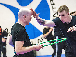 Touching heads using the hoop, Stef Noij, KMG Instructor from the Institute Krav Maga Netherlands, at the IKMS G Level Programme seminar today at the Scottish Martial Arts Centre, Alloa.
