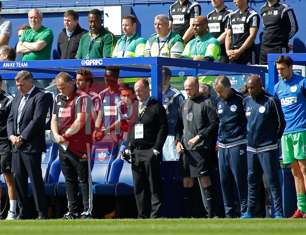 West Ham Manager, Sam Allardyce and Queens Park Rangers Manager, Chris Ramsey observe a minutes silence - Photo mandatory by-line: Mitchell Gunn/JMP - Mobile: 07966 386802 - 25/04/2015 - SPORT - Football - London - Loftus Road<br />  - QPR v West Ham United - Barclays Premier League