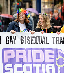 Pictured: Lothian MSP Kezia Dugdale (left) took part in the parade with her partner fellow MSP Jenny Gilruth.<br /> <br /> Thousands of marchers rallied outside the Scottish Parliament to celebrate the annual Scotia Pride event in Edinburgh.<br /> <br /> © Dave Johnston / EEm