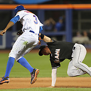 NEW YORK, NEW YORK - July 05: Curtis Granderson #3 of the New York Mets is tagged out while running to second by Miguel Rojas #19 of the Miami Marlins during the Miami Marlins Vs New York Mets regular season MLB game at Citi Field on July 05, 2016 in New York City. (Photo by Tim Clayton/Corbis via Getty Images)