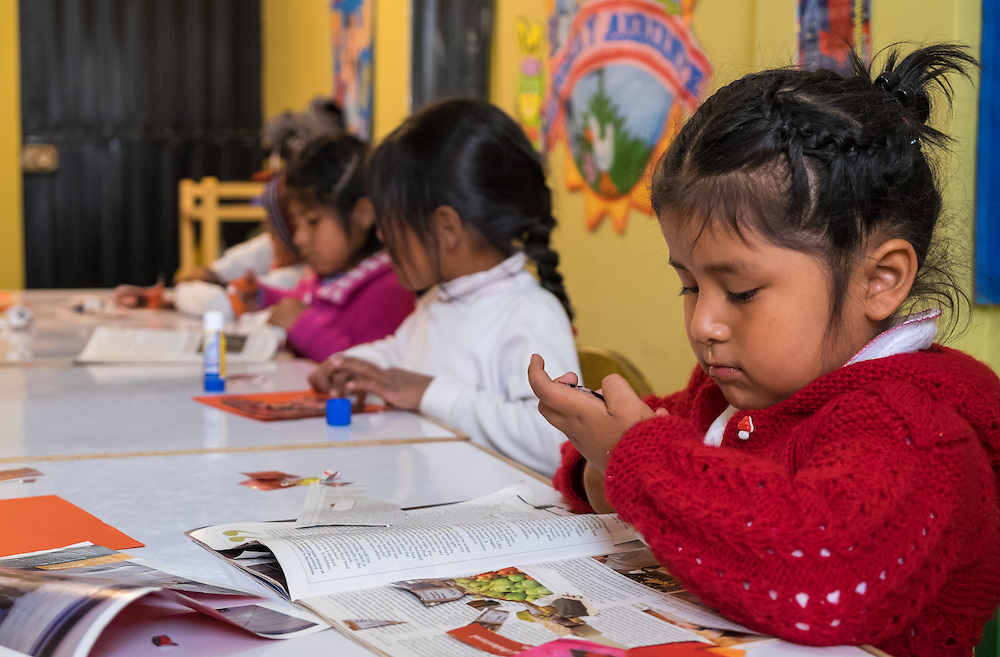 AREQUIPA, PERU - APRIL 8, 2014: Girls working in one of the many english classes given by HOOP Peru in the community of Flora Tristan. HOOP Peru is a NGO fully committed to breaking the cycle of poverty by empowering the Flora Tristan families through enhancing their education.