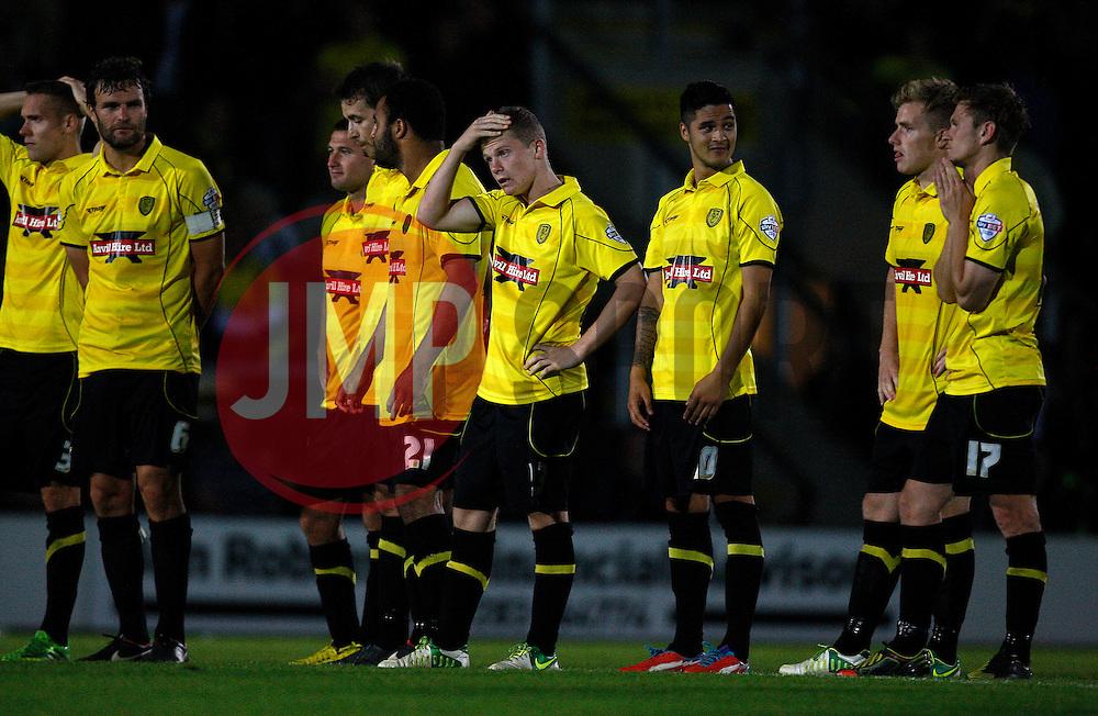 Burton players show their disappointment at the penalty defeat  - Photo mandatory by-line: Matt Bunn/JMP - Tel: Mobile: 07966 386802 27/08/2013 - SPORT - FOOTBALL - Pirelli Stadium - Burton - Burton Albion V Fulham -  Capital One Cup - Round 2