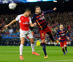 Arsenal's Alexis Sanchez challenges Jordi Alba of Barcelona  - Mandatory byline: Matt McNulty/JMP - 16/03/2016 - FOOTBALL - Nou Camp - Barcelona,  - FC Barcelona v Arsenal - Champions League - Round of 16