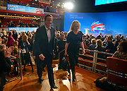 © Licensed to London News Pictures. 03/10/2012. Birmingham, UK Prime Minister David Cameron exits the conference hall with Ffion Hague on Day 1 at The Conservative Party Conference at the ICC today 7th October 2012. Photo credit : Stephen Simpson/LNP